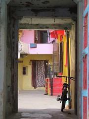 dungarpur (gerben more) Tags: dungarpur rajasthan colours colors bike bicycle cycle doorway gate india