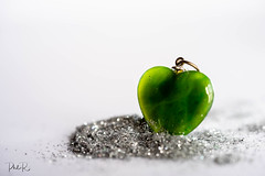 Shape of my Heart (PhilR1000) Tags: heart pendant macro macromondays green glass whitebackground glitter jewellery