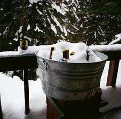 Ryan's beer cooler (1 of 1) (sailronin) Tags: winter cold beer pail tub railing snow trees film analog rolleiflex6008 kodakfilm ektar100 carlzeiss carlzeiss80mmplanar color