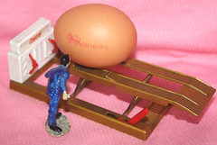 Going to work on an egg. (Yesteryear-Automotive) Tags: castrolservicelift castrol egg minimechanic