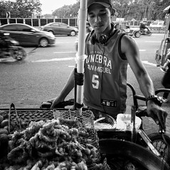back to the salt mines (Stitch) Tags: weekly vendor streetphotography quezoncity philippines cooking frying man standing