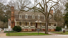 Colonial Tavern - and More Benches (John H Bowman) Tags: virginia williamsburg colonialwilliamsburg christmas christmas2015 christmasdecorations cwbuildings taverns colonialtaverns christianacampbellstavern signs cwsigns flags britishflags benches overcast january2016 january 2016 canon24704l