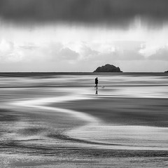 Coastal Therapy (Bruus UK) Tags: mawganporth beach bw blackwhite beachlife coast clouds coastal cloudy dogs walking marine sea seascape surf sand beachtherapy outdoorphotography photographymonthly digitalphotography mansbestfriend strolling mono minimal monochrome stormy darkclouds