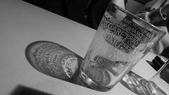 Light reveals the lettering 01 (byronv2) Tags: edinburgh edimbourg scotland glass drink beer stout ale letters lettering shadow shadows sixdegreesnorth pub night nuit edinburghbynight blackandwhite blackwhite bw monochrome newtown