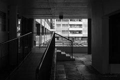 Golden Lane Estate (cybertect) Tags: carlzeissplanart50mmf14mm chamberlinpowellandbon cityoflondon crescenthouse ec1 goldenlaneestate greatarthurhouse london londonec1 sonya7ii architecture blackwhite blackandwhite building handrail monochrome ramp stairs