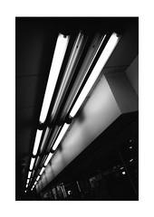 Tubes of Speed of Light (Thomas Listl) Tags: thomaslistl blackandwhite biancoenegro noiretblanc monochrome dark 35mm diagonal light lamps lines geometry graphical street abstract