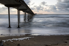 Ocean Beach Pier, San Diego, CA (Photos By Clark) Tags: california cities subjects beachshots location canon2470 unitedstates northamerica sandiego canon5div locale places where waves pier winter storm hightide pacific water rocks sunset foam longexposure 5seconds lightroom thesandiegoist