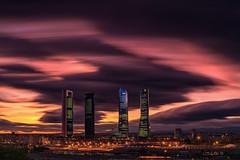 4 Towers III (darklogan1) Tags: madrid night nightphotography longexposure clouds wind skycraper cityscape panorama urban orange magenta logan darklogan1 sonyilce7rm3 sonyfe1635mmf28gm surreal