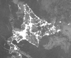 Hokkaido at Night in Late Spring 2019, Animated (sjrankin) Tags: 6april2019 1march20195april2019 gif animatedgif grayscale nasa usgs noaa hokkaido japan weather clouds snow lights cities sapporo night suominpp huge 4264mb