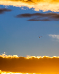 Hovering Near Heaven (eanwe) Tags: cloud helicopter light sky sunlight