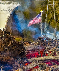 Burning Patriotism (Darrell Wyatt) Tags: fire bonfire flag farm barn heat radiation