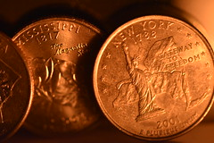 Candle Lit Quarters (Mikon Walters) Tags: coins currency quarters dollars cents money usd usa us united states america american silver nikon d5600 sigma 105mm macro lens photography close up shadows new york 1788 gateway freedom 2001 mississippi 1817 magnolia state candle lighting lit detail