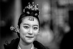 streetportrait 3 february (Gerrit-Jan Visser) Tags: bewerkt streetphotography blackandwhite amsterdam damsquare chinese dancer traditional girl shy beautiful shallow dof asian ornament portrait