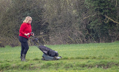 DSC_5066a Scawby North Lincolnshire Lady in Red Sweater Cutting the Grass on the Public Right of Way used by Dog Walkers (photographer695) Tags: scawby north lincolnshire lady red sweater cutting grass public right way used by dog walkers