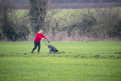 DSC_5061 Scawby North Lincolnshire Lady in Red Sweater Cutting the Grass on the Public Right of Way used by Dog Walkers (photographer695) Tags: scawby north lincolnshire lady red sweater cutting grass public right way used by dog walkers