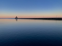 A Slight Tinge of Spring at Sunset (rbodgers) Tags: reflection gradient spring winter sunset lighthouse lake canal water duluth lakesuperior shotoniphone
