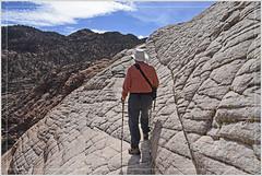 Upward Bound (Explored) (Runemaker) Tags: dl hiking hiker sandstone redrock slickrock mountain cliff wilderness nature landscape camelback sky clouds utah runemaker nikon d750