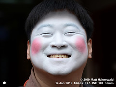 2013-06a Facing South Korea 2019 (01d) (Matt Hahnewald) Tags: matthahnewaldphotography facingtheworld people character head face white painted mask eyes orientaleyes facial expression highspirits fringe bangs consent fun concept culture humor art performer photoshoot mime artist bangkok thailand asia asian korean individual oneperson male adult young man portraiture detail physiognomy nikond610 nikkorafs85mmf18g 85mm 4x3ratio resized 1200x900pixels horizontal street portrait closeup headshot fullfaceview outdoor colour posingcamera awesome incredible smiling acting performing chubby pantomime paint makeup comedian mimic lookingatcamera eyecontact clarity 4of5