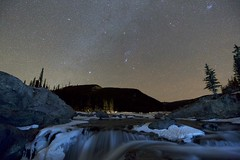 Night sky January (John Andersen (JPAndersen images)) Tags: alberta canon elbowfalls kananaskis mountains night orion pond river stars tamron trees winter