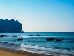 Ao Nang 2 (deepaqua) Tags: beach ocean andamansea krabiprovince aonang silhouette boat sand indianocean cliff thailand