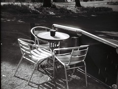 Table and chairs (Matthew Paul Argall) Tags: ansco50 fixedfocus 110 110film subminiaturefilm lomographyfilm 100isofilm grainyfilm blackandwhite blackandwhitefilm plasticlens toycamera