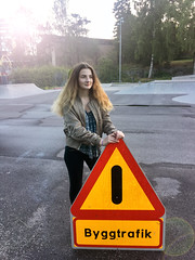 Girl Holding Road Sign at a Skate Park (Jonatan Svensson Glad (Josve05a)) Tags: cute child happy smiling people smile caucasian happiness looking childhood kid women person human pretty cheerful fun joy outdoors youth play playful playing outdoor children activity kids playground roadsign younggirl 14years