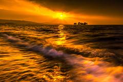 sunset 6340 (junjiaoyama) Tags: japan sunset sky light cloud weather landscape orange yellow contrast color lake island water nature winter wave rough reflection beam ray sunburst rain storm