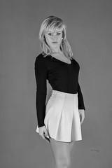 Mini skirt goes well with her figure (piotr_szymanek) Tags: ania aniaz woman young skinny face eyesoncamera studio portrait blonde blackandwhite 1k 20f 50f 5k 100f 10k 20k