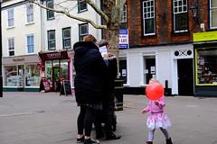 Writing Back and Balloon (Bury Gardener) Tags: burystedmunds britain suffolk streetphotography street streetcandids snaps strangers candid candids people peoplewatching folks fujixt3 fuji fujifilm england eastanglia traverse balloon