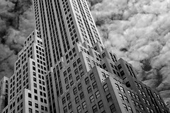 NYC Skyscraper in the Clouds (infrared) (dr_marvel) Tags: converging lines ir infrared blackandwhite building skyscraper clouds sky upward offices windows steps