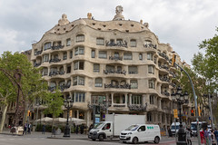 Corner building with conspicuous balcony design Casa Milà (La Pedrera) by Antoni Gaudi in Barcelona, Spain is declared as Unesco World Heritage (verchmarco) Tags: spain barcelona spanien architecture diearchitektur city stadt travel reise street strase building gebäude urban städtisch town dorf outdoors drausen tourism tourismus house haus noperson keineperson old alt sky himmel road sight sicht tourist daylight tageslicht landmark wahrzeichen modern cityscape stadtbild fun christmastree españa bar owl design day decoration camera kodak