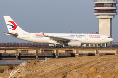 """CHINA EASTERN A330-243 B-5942 """"60th Anniversary"""" 0041 (A.S. Kevin N.V.M.M. Chung) Tags: aviation aircraft aeroplane airport airlines airbus plane spotting macauinternationalairport mfm taxiway a330200 a330 chinaeastern speciallivery tower"""