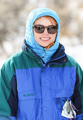 Hanna (wyojones) Tags: wyoming cody absarokamountains shoshonenationalforest sledding sliding hillside clearwatercreekcampground snow sled hood coat smile redhead sunglasses shades hanna