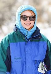 Hanna (wyojones) Tags: wyoming cody absarokamountains shoshonenationalforest sledding sliding hillside clearwatercreekcampground snow sled hood coat smile redhead sunglasses shades hanna wyojones