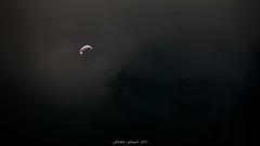 Flying in the Storm (Frédéric Fossard) Tags: sky ciel nuage cloud mist brume texture vol flight parapente sportextrême aile pilote aérien storm orage solitaire altitude vollibre dramaticsky moodysky mood soar soaring