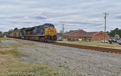 CSX N319-28 in Wingate (Travis Mackey Photography) Tags: csx n319 wingate nc monroe sub gevo train railroad locomotive trees grass sky building