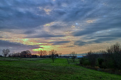 One February Morning - 021719 - 075301 (Glenn Anderson.) Tags: dawn sunrise clouds cloudsstormssunrisessunsets sky treeline trees landscape pastels solarreflection morning spring pasture fence grass