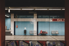 Subway Stories (Zesk MF) Tags: zesk subway sleeping street candid kalk cologne x100f fuji color red bank gymnastics framing weekend