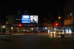 Advert (raindog) Tags: primelens 35mm traffic kingston longexposure a6000 lighttrails night sony advert billboard f45