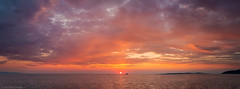 Burning the day away (Through_Urizen) Tags: category erdek kapidag panorama places seascape sunset turkey canon1585mm canon70d canon outdoor sunglow lowsun sea water marmarasea coast coastal landscapephotography clouds colourful scenery island headland ferry boat evening sky skyline bay