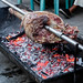 A giant beef portion being grilled