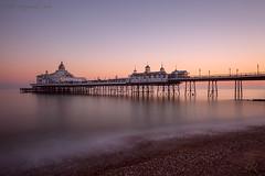 Eastbourne Pier Sunset (Pete 5D...©...) Tags: sunset dusk architecture structure building le sea water reflection coast pebble beach shore horizon pink hue eastbourne pier south england uk long exposure longexposure