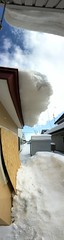 Snow Over-Hanging Roof 2 (sjrankin) Tags: 18february2019 edited kitahiroshima hokkaido japan snow ice weather roof sliding icicles sky panorama