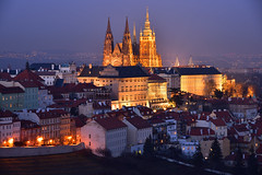 Prague Castle at St. Vitus Cathedral at night - 1 of 2 (Pavel's Snapshots) Tags: vivid blue orange castle cathedral ancient old medieval historic historical nikon nikkor d750 105mm illumination illuminated lighting destination famous place area town city urban prague praha czech czechrepublic europe european heritage gothic evening dusk twilight night winter colorful district houses roofs haze street hill tripod cloudy purple spire spires towers roof lights metropolitan