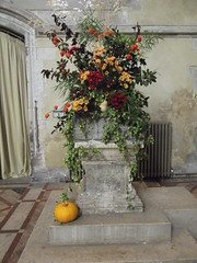St. Cross Church, Flowery Font (catrionatv) Tags: winchester stcross stcrosschurch stfaithschurch 1507 decorated font michaelmasfestival curtain tiles mosaic plinth radiator fruit flowers