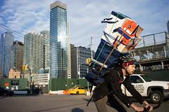 Vertical (dtanist) Tags: nyc newyork newyorkcity new york city sony a7 7artisans 35mm manhattan midtown hudson yards hells kitchen bike bicycle bicyclist messenger building skyscrapers