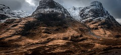 The three sisters of glencoe (joshkfabian) Tags: sharness ridges dehaze landscapephotography landscape filter hiking climbing streams waterfalls trails rain snow colors editing dodge burn dodgeandburn raysoflight dreamy adventures carrides travel beginner nikon panorama pano highlands cliffs rocks black darkness shadows light brown red blue moody clouds darksky scotland glencoe winter
