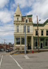 Building — Carlisle, Kentucky (Pythaglio) Tags: building structure carlisle kentucky unitedstatesofamerica us historic commercial ornate nicholascounty sidewalk street clouds storefront turret tower 11windows eclectic romanesque queenanne cornice