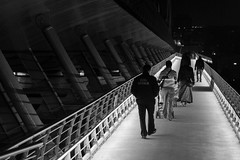 stay on line / an evening like any other (Özgür Gürgey) Tags: 2014 50mm bw d7100 nikon architecture bridge cropped diagonal evening grainy lines lowlight people repetition street subway istanbul