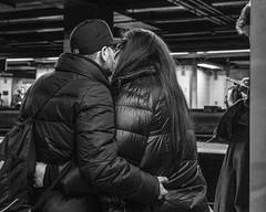 Getting a Grip (John St John Photography) Tags: streetphotography candidphotography timessquare subwaystation mta newyorkcity newyork commuters lovers embrace bw blackandwhite blackwhite blackwhitephotos johnstjohnphotography